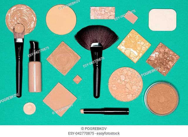 Corrective makeup set: concealer pencil, primer, liquid and cream foundation, various functional types of cosmetic powder with make up brushes and sponges