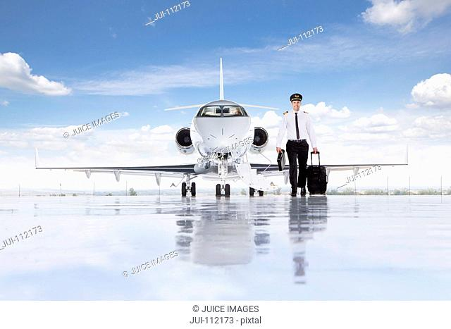 Pilot walking away from private jet