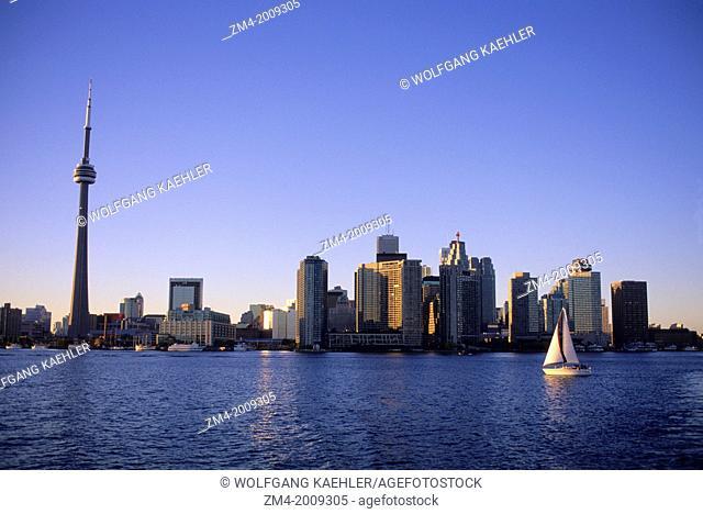 CANADA, ONTARIO, TORONTO, SKYLINE AT DUSK, SAILBOAT
