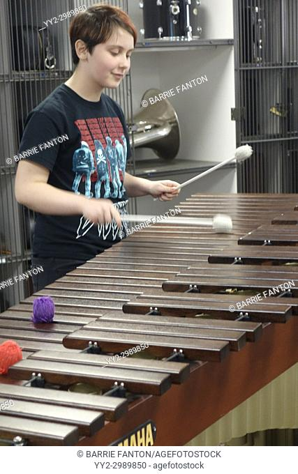 6th Grade Girl Practicing Marimba, Wellsville, New York, USA