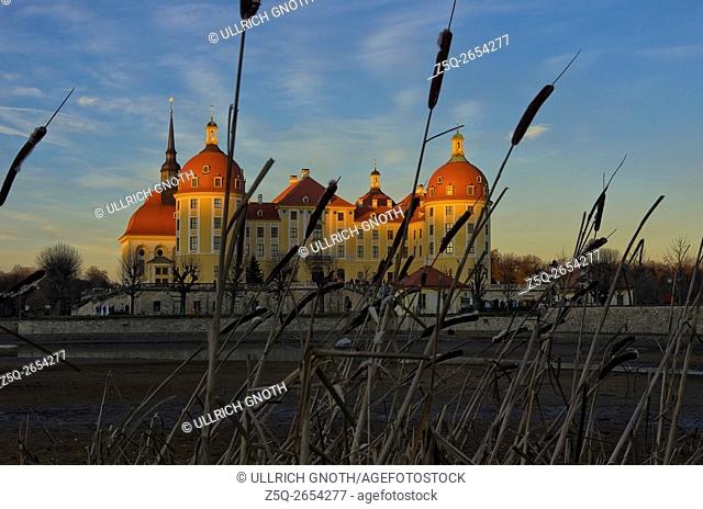 The hunting lodge and Baroque chateau Moritzburg Castle near Dresden, Saxony, Germany, at sunset as seen as from the South