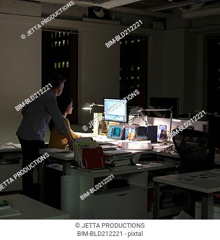 Business people working late in office