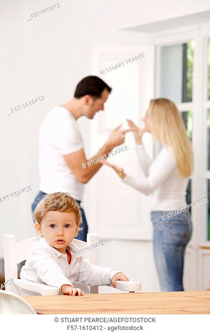 Parents arguing in front of their young child