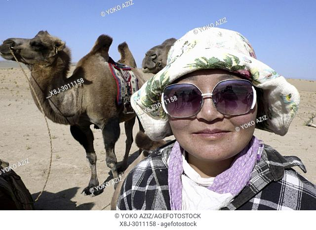 Woman with camel, Gobi desert, Mongolia