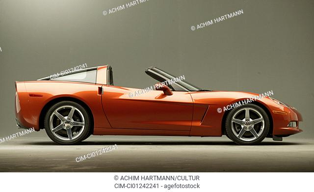 Car, GM Chevrolet Corvette C6, roadster, Convertible, red, model year 2003-, FGAH, standing, upholding, side view, Studio admission, open top