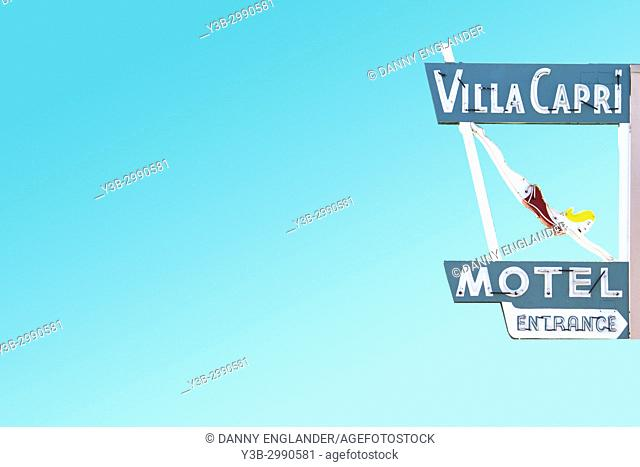 Retro vintage motel sign with a bright blue sky in the background