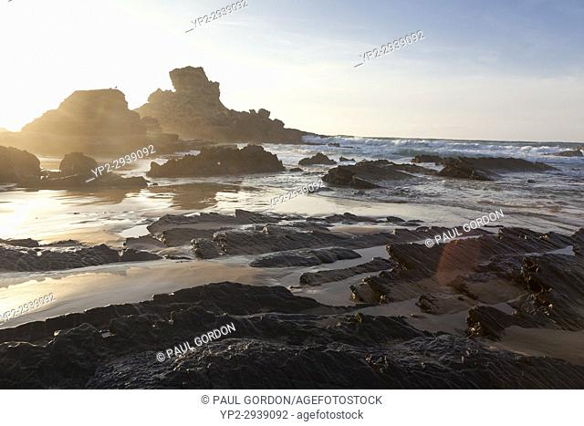 Vila do Bispo, Portugal: Rugged sea stacks at Praia do Castelejo at sunset in Southwest Alentejo and Vicentine Coast Natural Park