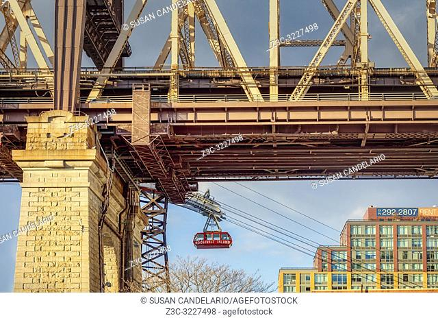 Roosevelt Tram Underneath The 59 St Bridge - View from beneath the Ed Koch 59th Street Queensboro bridge with the red Roosevelt Island tramway.