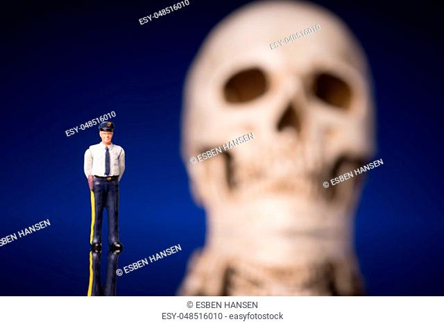 Police and blurry skull isolated om blue black background
