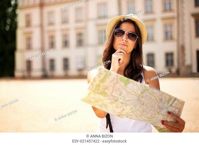 Tourist girl with map wondering where she should go