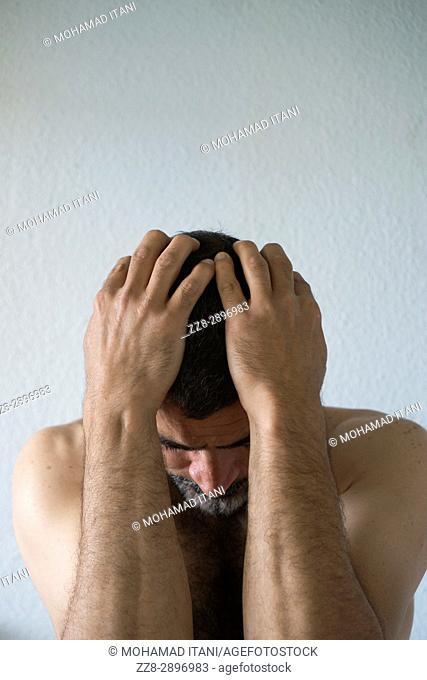 Miserable man head in hands