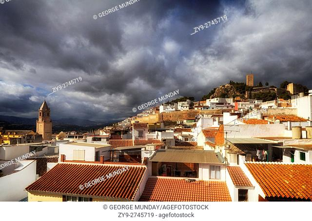 Church of St. John the Baptist and the 13th Century Moorish Castle tower ,over the rooftops, . Vélez-Málaga, the capital of the Axarquía comarca in the province...