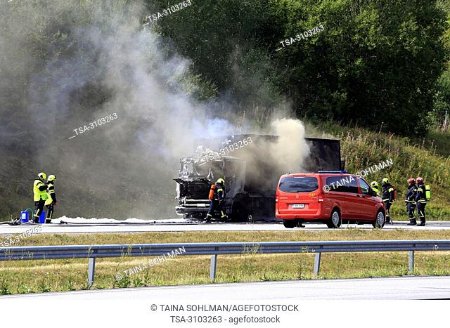 SALO, FINLAND - AUGUST 17, 2018: Firefighters extinguish vehicle fire on E18 in Salo. Delivery truck is completely destroyed in fire
