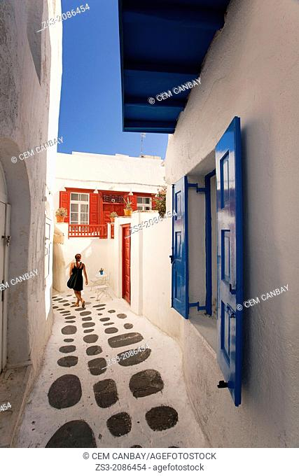Woman in the alleys of town center, Mykonos, Cyclades Islands, Greek Islands, Greece, Europe