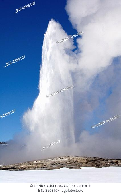 Geyser Old Faithful, hot springs in winter, Yellowstone National Park, USA