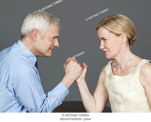 Mature couple arm wrestling