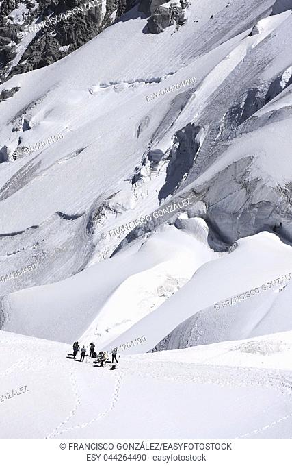 Mountaineers ascending to Mont Blanc in Chamonix, France. Vertical image