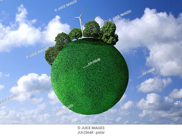 Grass covered globe in sky with wind turbines and trees
