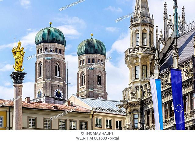 Germany, Bavaria, Munich, View of Mary's Square, Marian column and Cathedral of Our Lady and new town hall right