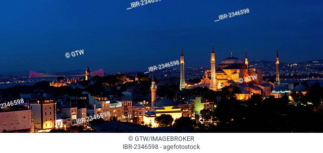 Panorama over Hagia Sophia museum and Bosphorus bridge at night, Istanbul, Turkey