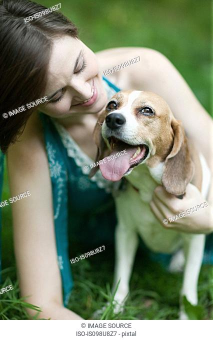 Woman with her pet beagle