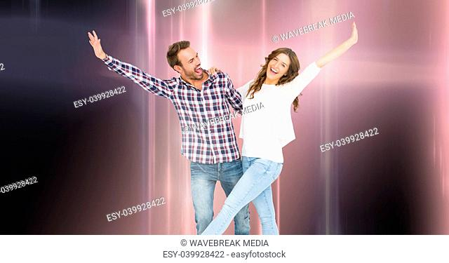 Couple dancing with glowing light streams