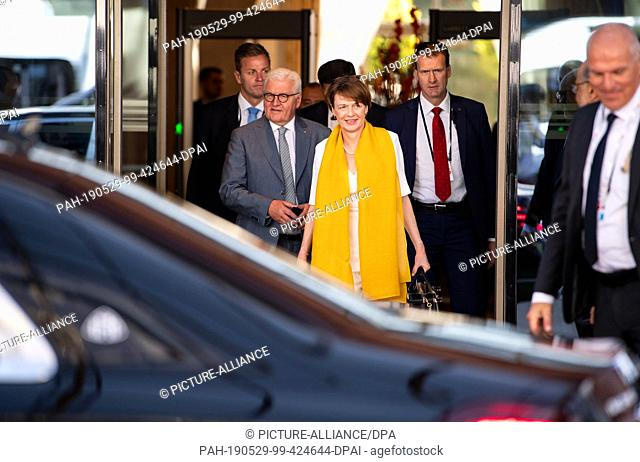 29 May 2019, Uzbekistan, Taschkent: Federal President Frank-Walter Steinmeier and his wife Elke Büdenbender come out of the delegation hotel and go to their...