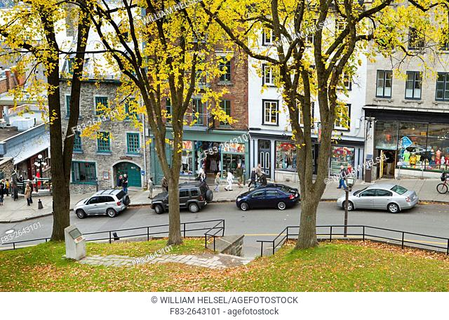 Shops and visitors on steep street connecting the upper and lower towns of old Quebec, Cote de la Montagne, Quebec City, Quebec, Canada, October