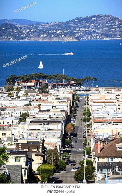 View of houses in marina district of San Francisco with hill towns across the Bay