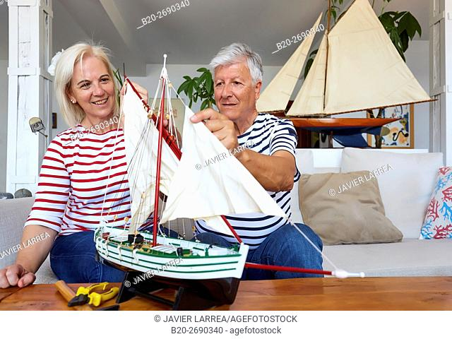 Senior couple, 60-70, building model sailboat, Whaleship, Getaria, Gipuzkoa, Basque Country, Spain, Europe