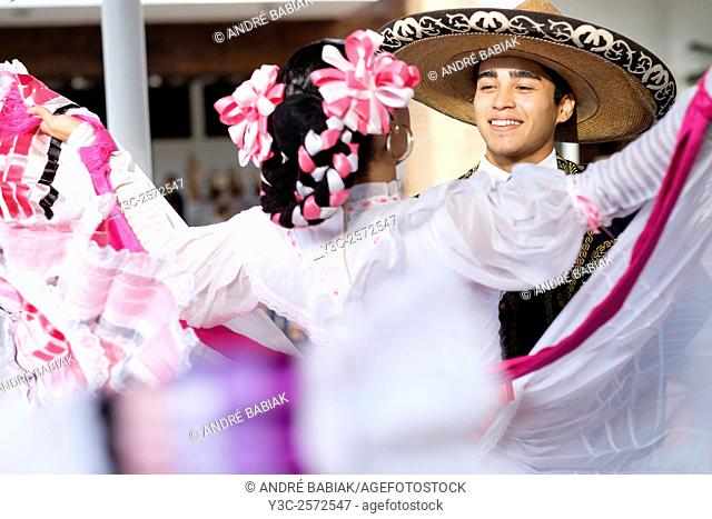 Young man and woman dancing. Puerto Vallarta, Jalisco, Mexico. Xiutla Dancers - a folkloristic Mexican dance group in traditional costumes representing the...