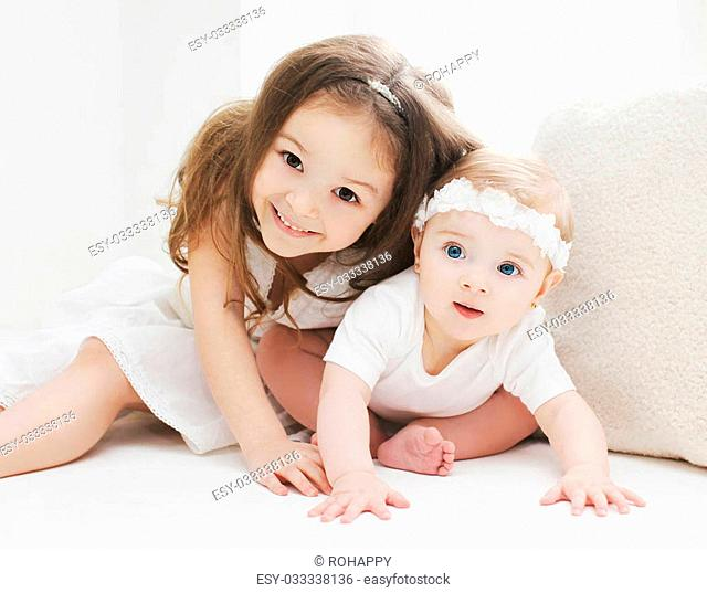Children playing in white room at home