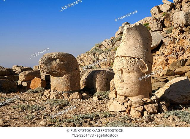 Statue heads, from right, Antiochus & Eagle in front of the stone pyramid 62 BC Royal Tomb of King Antiochus I Theos of Commagene, east Terrace