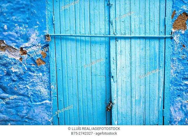 Blue door locked with a padlock. Chaouen, Tanger-Tetouan, Morocco