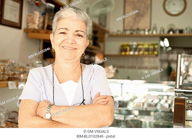 Smiling Hispanic woman in cafe