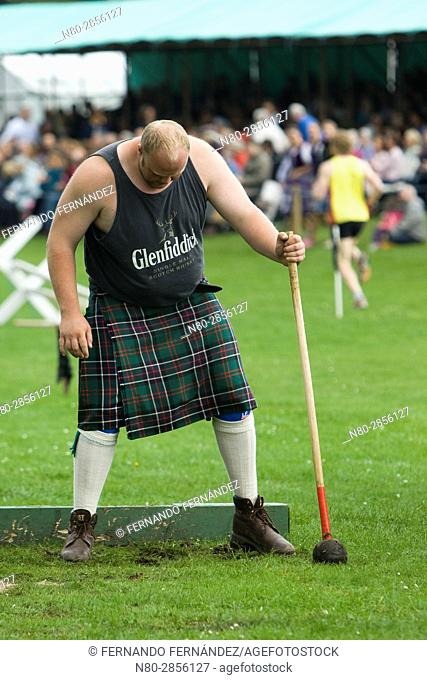 The hammer throw, a weight for distance event. Highland Games. Aboyne. Aberdeenshire. Scotland. Europe