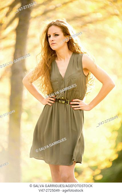 Young woman with a dress in the forest of poplars, Alboy, Genoves, Valencia, Spain, Europe