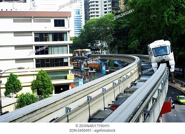 Kuala Lumpur, Malaysia - Marh 20, 2012: Monorail train arrives at a train station. Kuala Lumpur metro consists of 6 metro lines operated by 4 operators