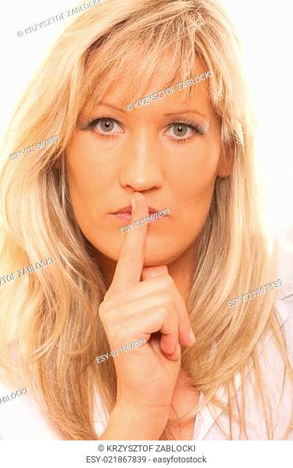 Woman asking for silence finger on lips hush gesture