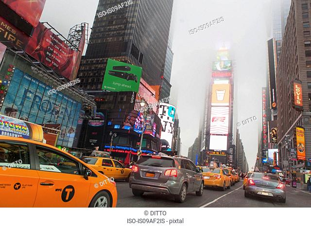 Traffic and mist, Times Square, New York City, USA