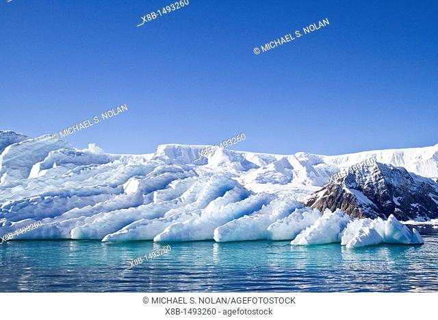 Icebergs in Neko Harbor on the western side of the Antarctic Peninsula during the summer months, Southern Ocean  MORE INFO An increasing number of icebergs are...