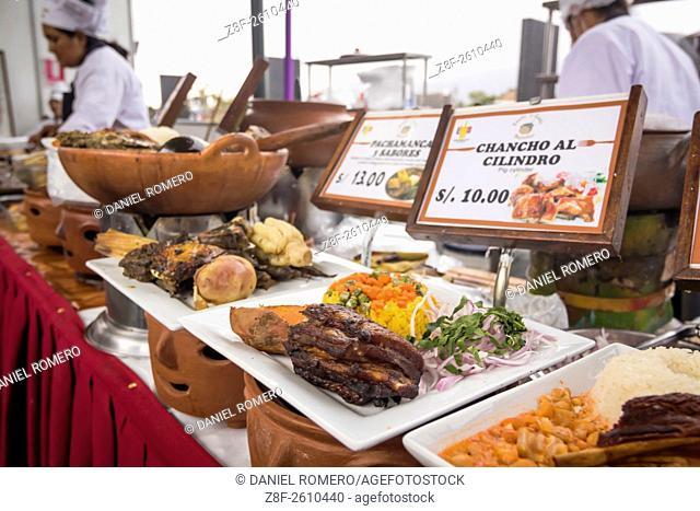 "Peruvian food dishes: """"Chancho al cilindro"""". Peruvian seasoning and flavor, food fair. La Limeñita boulevard, Camana Street, historical Center; Lima district"