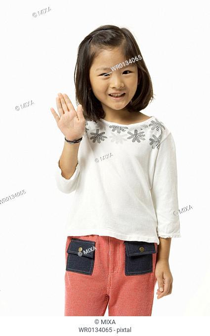 Elementary age girl waving