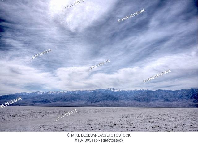 Salt Flats in Bad Water Basin in Death Valley under heavy cloud cover that seems to look other worldly