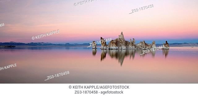 Snow-covered tufa towers on Mono Lake, under pink and blue dusk sky  Mono County, Eastern Sierras, California, USA