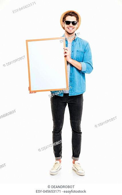 Close-up portrait of a smiling bearded man holding blank board isolated on the white background
