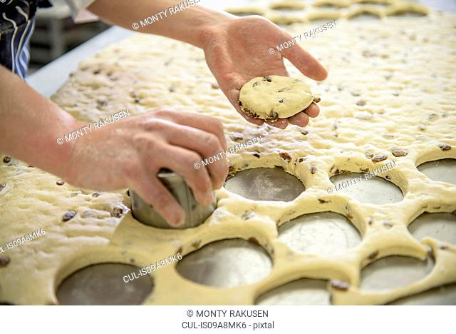 Baker cutting out fruit scones, close up