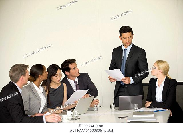 Executive giving presentation in meeting