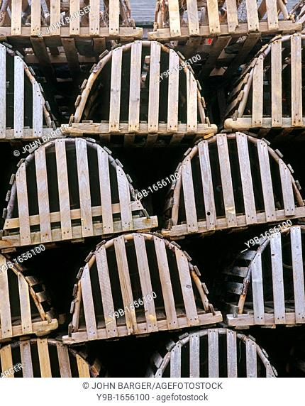 Tidy stack of wooden lobster traps, Trout River, western Newfoundland, Canada