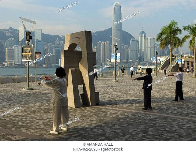Early morning Tai Chi class on the Tsim Sha Tsui waterfront, Kowloon, Hong Kong, China, Asia